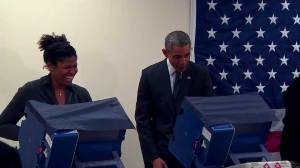 Obama turns voting process into funny exchange with man's girlfriend