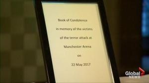 Theresa May signs book of condolences for Manchester attack victims