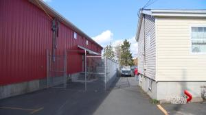 Dartmouth business owners disputing over new fence