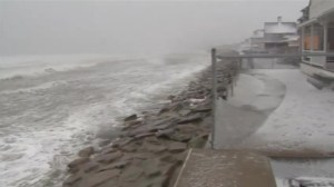 Sea wall breached in Massachusetts town