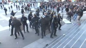 Demonstrators clash with police after first round results of French presidential election