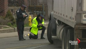 Female cyclist hit by large transport truck on Dufferin Street