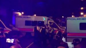 Onlookers react after man appears to be taken into custody at site of vehicle ramming in London