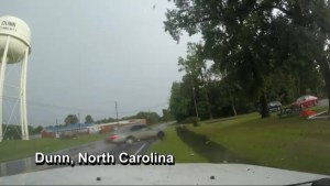 Local news team covering dangerous driving conditions films car losing control