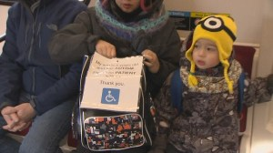 Toronto mom carries sign about son's autism