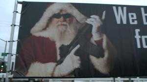 Billboard featuring gun toting Santa Claus draws ire