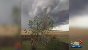 Alberta man mows lawn with tornado behind him