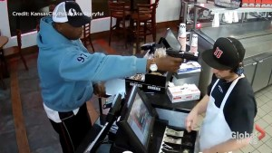 Fast food clerk unfazed as robber sticks a gun in his face