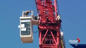 Man under arrest after climbing giant crane in downtown Calgary
