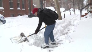 Americans dig out of weekend-long snow storm
