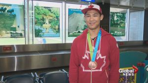 Iwaasa returns home, sporting Pan Am Games medal