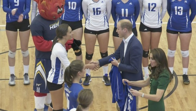 Kaitlynn Given presenting the royals with a UBC Heat jersey.