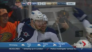Sports reporter Jim Toth of CJOB tees up the Winnipeg Jets game