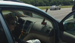 Axe flies through car's windshield on a Massachusetts highway