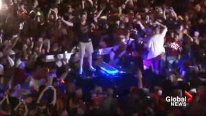 Rowdy Cavaliers fans fill streets, destroy cop cruiser