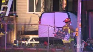 Stolen cargo van crashes into house