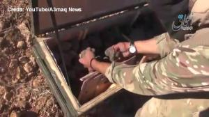 ISIS taunts US with video showing they seized a weapons airdrop meant for Kurdish fighters