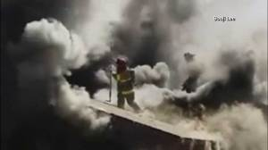 Footage shows firefighter fall through burning roof