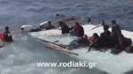 Migrant boat runs aground on coast of Greek island of Rhodes
