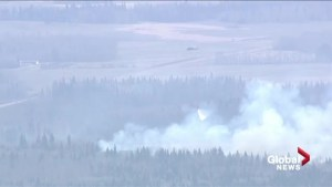 Helicopter water bombs wildfire in Lamont County, northeast of Edmonton