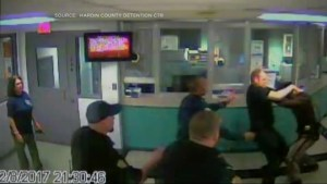 Security camera captures brawl between cop, guard inside Kentucky jail
