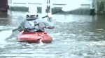 South Carolinians kayak in flooded streets