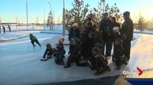 Edmontonians teach a Syrian family about hockey