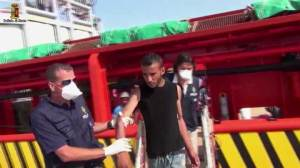 Italian police arrest man suspected of trafficking migrants