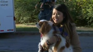 Nurse treated for Ebola reunites with dog Bently