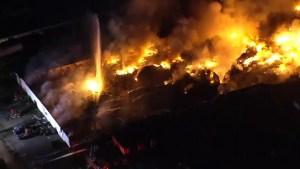 Firefighters battle massive warehouse fire