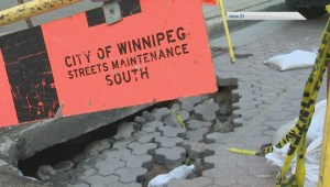 Winnipeg sinkhole caused by vacant St. Charles Hotel basement wall collapse: City