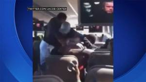High school football coach caught on camera fighting with player on school bus