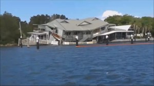 Half of lakefront restaurant collapses into water in Australia