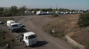 Raw video: Part of Russian aid convoy heads back after delivering cargo