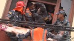 Man trapped under rubble and dead body finally pulled out by rescue workers