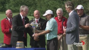 RBC Canadian Open: 2014 champion Tim Clark hoists the trophy
