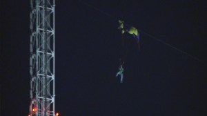 Base jumper gets tangled in support wires shortly after jump
