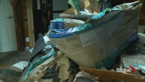 Crane smashes through Regina house