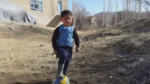 Young Afghan boy wears Lionel Messi made of plastic bag, gets soccer star's attention