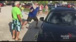 Man breaks BMW window on hot day to free dog