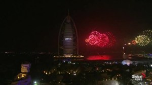 Dubai sky lit up by New Year's fireworks hours after skyscraper fire