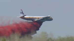 Water bombers drop repellent to help tame wildfire in Fort McMurray