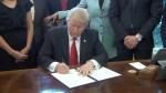 Donald Trump signs executive order aimed at slashing regulations