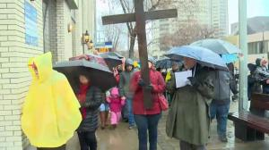 Good Friday Way of the Cross walk honors Jesus' journey before crucifixion