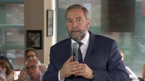 Tom Mulcair fights back tears as he discusses plight of Syrian refugees