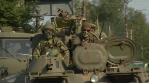 Armoured vehicles driven by pro-Russia rebels drive towards Krasnodon