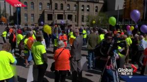 Opposing groups protest southwest transitway
