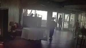 Surveillance footage captures moment boat crashes into restaurant