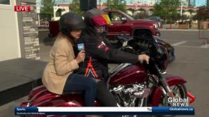 Leslie Horton hops on the Calgary Stampede Lotteries Harley-Davidson