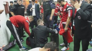 Serbian police search Albanian soccer team after soccer brawl